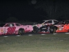 late-model-winner-18-jamie-fisher-and-second-place-finisher-16-mark-lamberton-slide-through-lap-traffic-at-devils-bowl