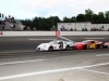 Spencer Davis (129) pushing Mark Beard (45) deep into turn 4