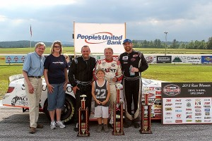 (L-R) Broadcaster Ken Squier, People's United Bank Financial Services Manager Sharon Kendall (Fair Haven, VT), Josh Masterson, Nick Sweet, and Chip Grenier in People's United Bank 100 victory lane in 2013 at Devil's Bowl Speedway.  (MemorEvents photo)