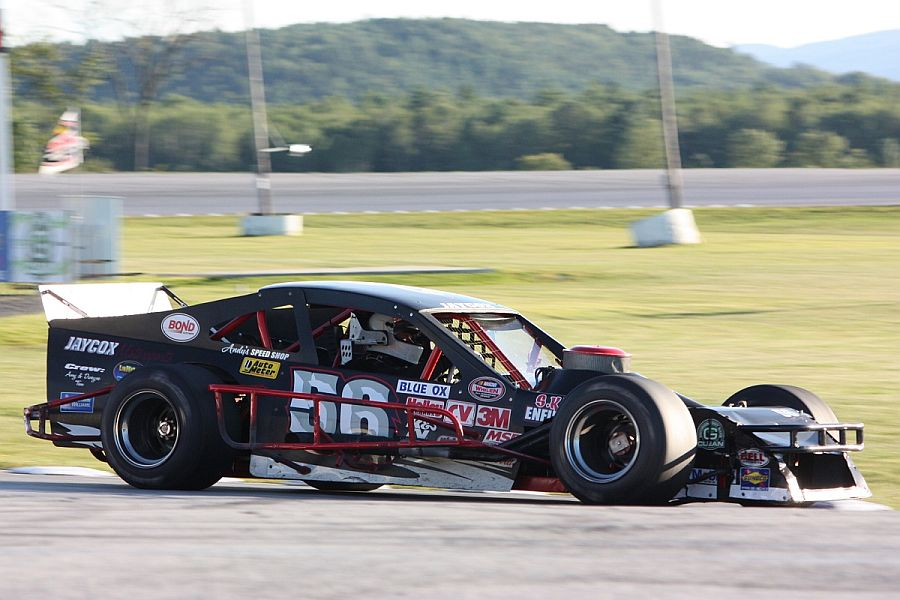 Bruce Jaycox of Hartland, VT wheels his SK Light Modified around Devil's Bowl Speedway during an exhibition last August. The fast, low-slung cars will race at the track nine times in 2014. (MemorEvents photo)