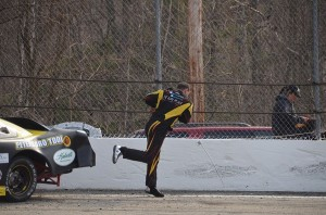 Kyle Welch throwing is window net rod after getting wrecked in the first race with a brand new Distance Chassis ACT race car