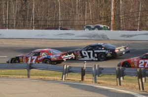 #17 Eddie MacDonald passing Joey Polewarczyk Jr for the race lead on the reatrt with 4 laps to go. eventual 3rd place finisher Wayne Helliwell Jr in tow