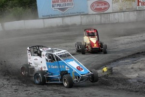 Joe Krawiec (6) leads Josh Sunn (75) & Ray Miller (1) off turn 4 in USAC Dirt Midget action