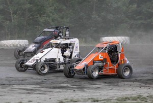 Tim Hodge (5), Ken Schrader (29) & Adam Pierson (76M) fight for position durning the USAC DMA Feature