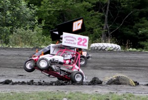Lauren Boisvert with the front end up high in 500cc Granite State Mini-Sprint action, That is MAtt Hoyt on her outside