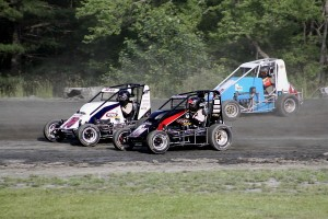 Josh Sunn (76), Adam Pierson (76w) & Joe Krawiec (6) battle in USAC Dirt Midget action