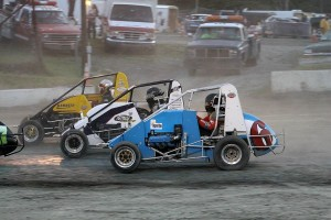 Scott Viets (2), Josh Sunn (76) & Joe Krawiec (6) 3 winde during the non-stop USAC Dirt Midget Feature
