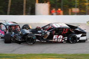 Carl Medeiros, Jr. (50) tangles with Dwight Jarvis (28) in VMRS qualifying.