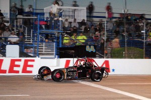 Mike Murphy flashes under the checkers for the Supermodified win.
