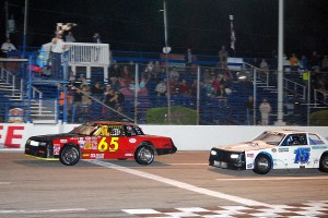 Jim Piaseczny leads Dennis Dumas to the Hobby Stock checkers.