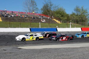 Tyler Church(7) and Harrison Burton (12) apply pressure to the leader, Tyler Dippel (1)