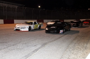 Garrett Campbell (12) and Randy Gentry (09) lead the field of 30 cars into turn 1