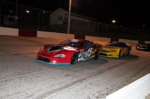 Jay Fogleman (4) pushes Jody Lavendar (115) into turn 1