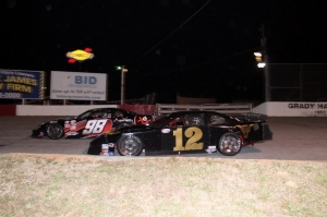 Garrett Campbell (12) laps Jody Measmer (98)  in turn 3