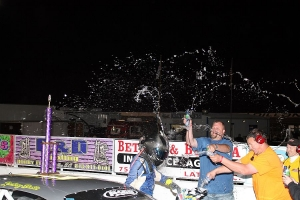 Zachary Dabbs celebrates his first Pro Late model win with his crew in victory lane
