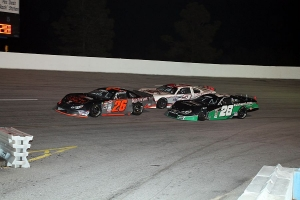 Jared Irvan (28)  and Trevor Noles (2) gang up on Preston Peltier  in turn 3