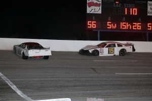 Lee Hansard (89) and Tanner Rumberg (15) spin in turn 3 to bringing out a  caution bunching the field back up.