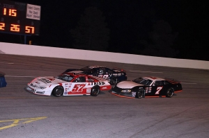 Cole Timm (57) tries to hold off Daniel Hemric (98h) and Tyler Church for 5th place