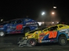 Jason Gray (00) and Adam Pierson (15) fight for the lead in the OctoberFast 100 at Canaan Dirt Speedway.